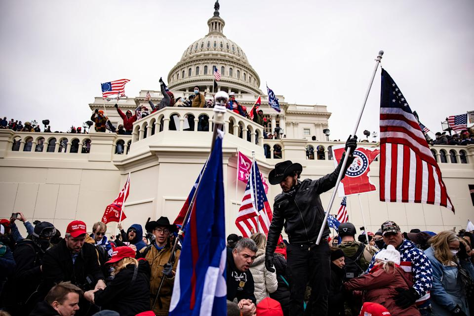 <p>Trump incited Capitol 'insurrection' to overturn election loss, claim Democrats in impeachment report</p> (Samuel Corum/Getty Images)