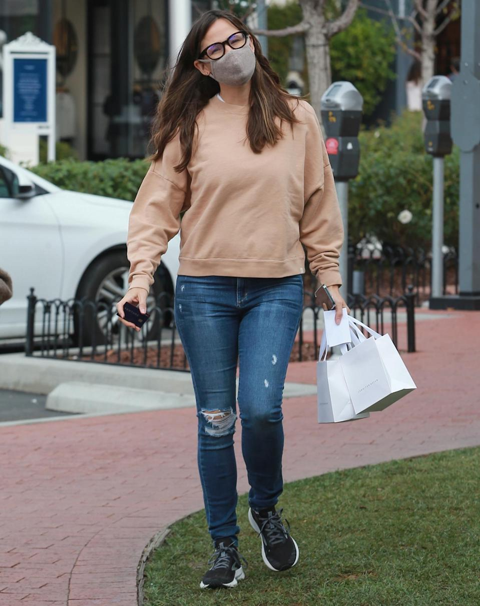 <p>Jennifer Garner keeps it casual as she goes shopping in a tan sweatshirt and jeans on Monday in Pacific Palisades, California.</p>