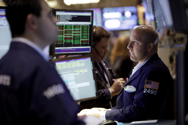 Traders work on the floor of the New York Stock Exchange, Thursday, Nov. 15, 2012. Stock indexes are inching higher in early trading Thursday after U.S. retail giants Wal-Mart and Target turned in mixed earnings reports.(AP Photo/Seth Wenig)