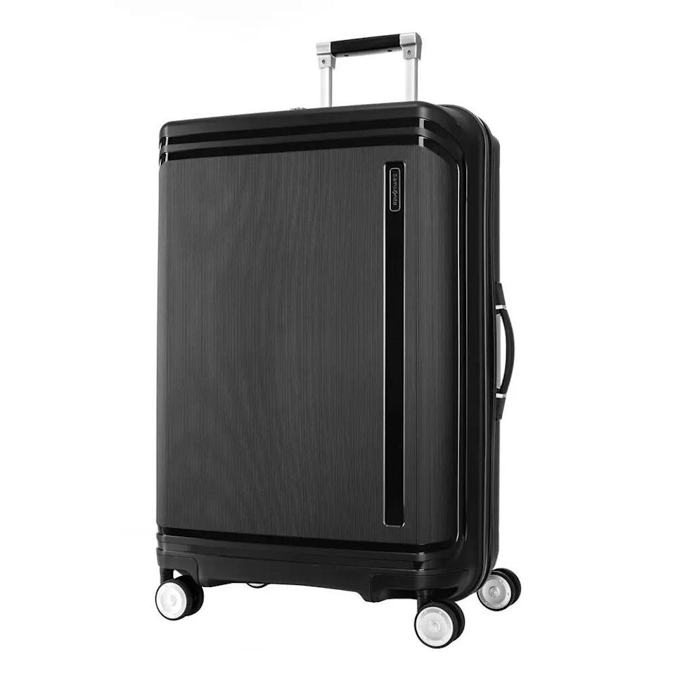 """<p><strong>Samsonite</strong></p><p>samsonite.com</p><p><strong>$249.99</strong></p><p><a href=""""https://go.redirectingat.com?id=74968X1596630&url=https%3A%2F%2Fshop.samsonite.com%2Fluggage%2Fchecked-luggage%2Fhartlan-large-spinner%2F112369XXXX.html&sref=https%3A%2F%2Fwww.redbookmag.com%2Flife%2Fg37394352%2Fessential-travel-items%2F"""" rel=""""nofollow noopener"""" target=""""_blank"""" data-ylk=""""slk:Shop Now"""" class=""""link rapid-noclick-resp"""">Shop Now</a></p><p>This is one for the over-packers...or someone traveling for a long stretch of time. The case has room for plenty of stuff and a few different compartments to organize it all. It also has an easy-to-access TSA 3-dial combination recessed lock to keep you secure.</p>"""