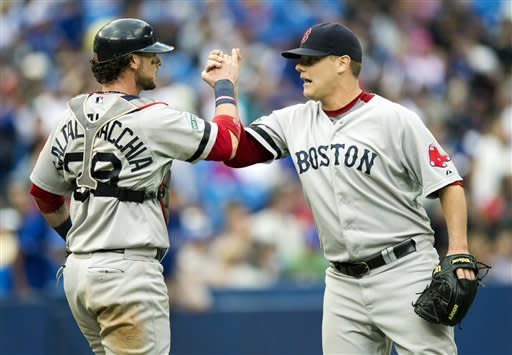Boston Red Sox pitcher Andrew Bailey and catcher Jarrod Saltalamacchia celebrate after defeating the Toronto Blue Jays during their baseball game in Toronto on Saturday, Sept. 15, 2012. (AP Photo/The Canadian Press, Frank Gunn)