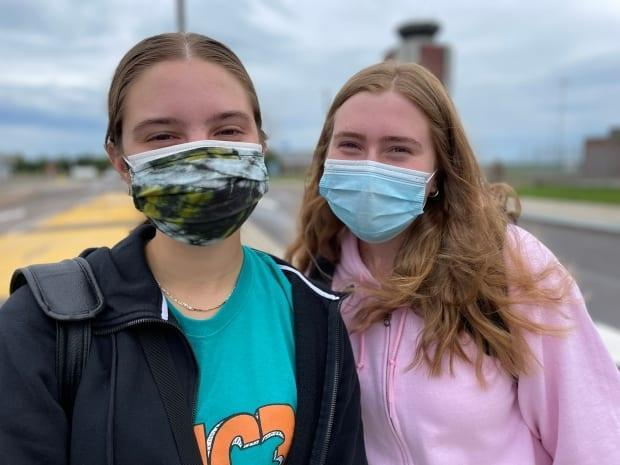 Anna, left, and Julia Rhymes haven't seen their family in the Maritimes since before the COVID-19 pandemic.  (Tony Davis/CBC - image credit)