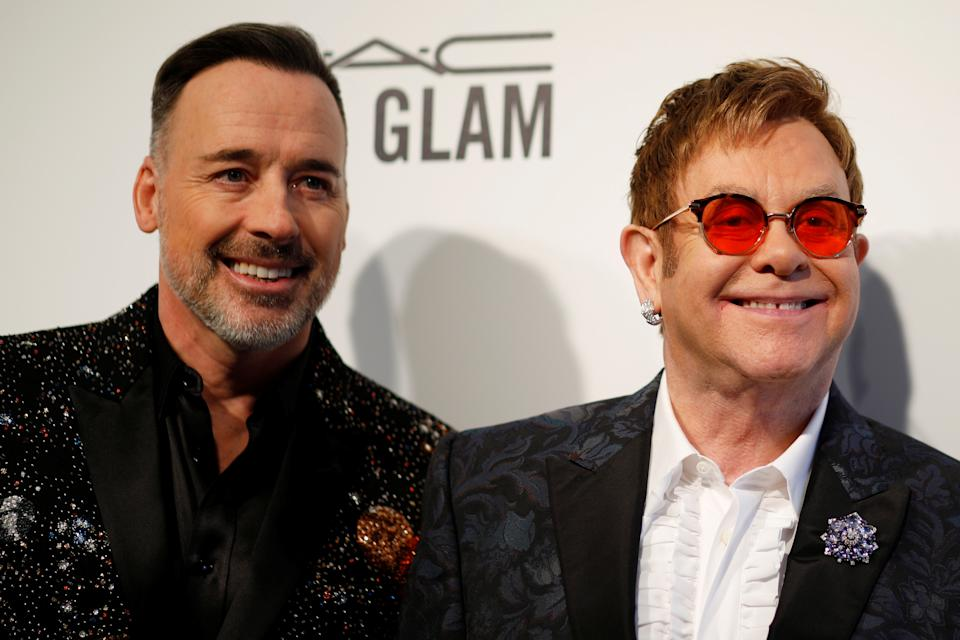 Elton John and his husband David Furnish (L) arrive at the 2017 Elton John AIDS Foundation Academy Awards Viewing Party in Los Angeles, California, U.S., February 26, 2017.   REUTERS/Brian Snyder