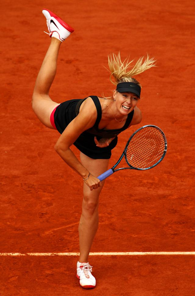 PARIS, FRANCE - JUNE 09: Maria Sharapova of Russia serves in the women's singles final against Sara Errani of Italy during day 14 of the French Open at Roland Garros on June 9, 2012 in Paris, France. (Photo by Clive Brunskill/Getty Images)