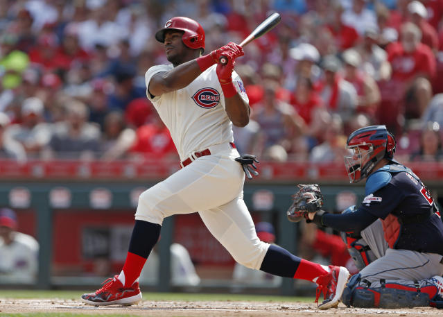 FILE - In this July 6, 2019, file photo,Cincinnati Reds' Yasiel Puig, left, follows through on a two-run home run off Cleveland Indians starting pitcher Shane Bieber during the first inning of a baseball game, in Cincinnati. The Indians bulked up for the playoff race by trading temperamental starter Trevor Bauer before the deadline to Cincinnati in a three-team deal they hope can help them run down the Minnesota Twins. Cleveland, which trails the AL Central by three games but leads the wild-card race, sent Bauer to the Reds for slugger Yasiel Puig and left-hander Scott Moss. The Indians also acquired outfielder Franmil Reyes, lefty Logan Allen and infield prospect Victor Nova from the San Diego Padres, who acquired outfielder Taylor Trammel from the Reds.(AP Photo/Gary Landers, File)