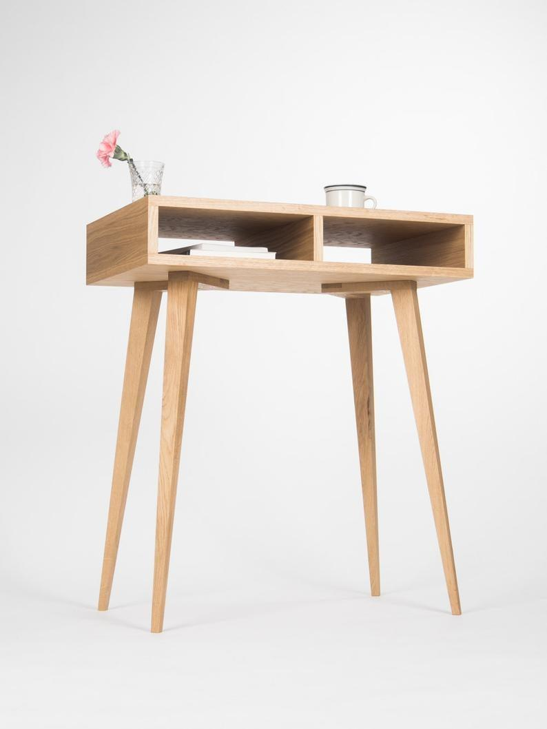 "Not only is this desk handmade in a variety of soothing oaks; it's also a major space saver with its simple design. <br><br><strong><em><a href=""https://www.etsy.com/shop/MoWdwrk?ref=simple-shop-header-name&listing_id=400600673"" rel=""nofollow noopener"" target=""_blank"" data-ylk=""slk:Shop Etsy"" class=""link rapid-noclick-resp"">Shop Etsy</a></em></strong><br><br><strong>MoWdwrk</strong> Small Oakwood Desk, $, available at <a href=""https://go.skimresources.com/?id=30283X879131&url=https%3A%2F%2Fwww.etsy.com%2Flisting%2F400600673%2Fentryway-table-hallway-table-small-desk"" rel=""nofollow noopener"" target=""_blank"" data-ylk=""slk:Etsy"" class=""link rapid-noclick-resp"">Etsy</a>"