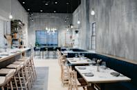 "This winter, imbibe on Greek wines and feast on Aegean small plates in an intimate, high design setting at newcomer <a href=""https://krasiboston.com"" rel=""nofollow noopener"" target=""_blank"" data-ylk=""slk:Krasi Meze & Wine"" class=""link rapid-noclick-resp"">Krasi Meze & Wine</a> in <a href=""https://www.cntraveler.com/gallery/best-restaurants-in-boston?mbid=synd_yahoo_rss"" rel=""nofollow noopener"" target=""_blank"" data-ylk=""slk:Boston's"" class=""link rapid-noclick-resp"">Boston's</a> Back Bay. At <a href=""https://thedialcentralsq.com"" rel=""nofollow noopener"" target=""_blank"" data-ylk=""slk:The Dial"" class=""link rapid-noclick-resp"">The Dial</a> in Cambridge, noted chef Justin Urso serves dishes including moqueca (a Brazilian shellfish stew), Caribbean-inspired jerk quail, buñuelos (Colombian cheese fritters), and kinilaw (coconut rich, Filipino ceviche). For Boston's freshest raw selections—not to mention the city's best lobster roll—we recommend the tried-and-true <a href=""https://www.row34.com/boston/"" rel=""nofollow noopener"" target=""_blank"" data-ylk=""slk:Row 34"" class=""link rapid-noclick-resp"">Row 34</a>. And for a fun night of tiki drinks and superb Asian small plates, reserve in advance at <a href=""https://www.cntraveler.com/restaurants/boston/uni?mbid=synd_yahoo_rss"" rel=""nofollow noopener"" target=""_blank"" data-ylk=""slk:Uni"" class=""link rapid-noclick-resp"">Uni</a>, a contemporary izakaya helmed by Tony Messina, a James Beard Best Chef winner."