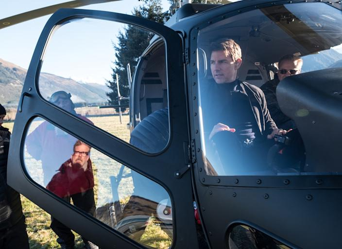 """Director Christopher McQuarrie, in window reflection, and Cruise on the set of """"Fallout."""" <span class=""""copyright"""">(David James / Paramount Pictures)</span>"""