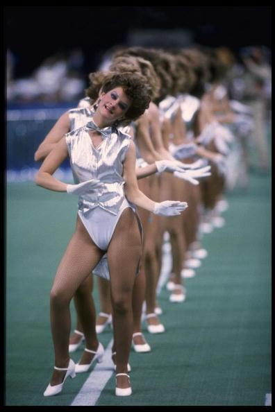 """<div class=""""caption-credit""""> Photo by: Getty Images/Mike Powell</div><div class=""""caption-title""""></div>High-cut leotards, silver lame, blue eye shadow… Yep, it's the eighties! Poofy-haired dancers interpreted a futuristic halftime show theme in 1986, at the Louisiana Superdome in New Orleans."""