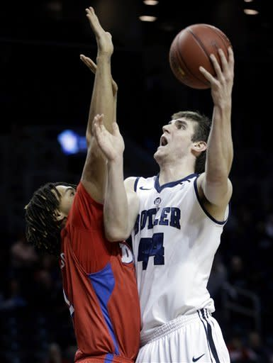 Butler's Andrew Smith, right, shoots over Dayton's Jalen Robinson during the first half of an NCAA college basketball game at the Atlantic 10 Conference tournament in New York, Thursday, March 14, 2013. (AP Photo/Seth Wenig)