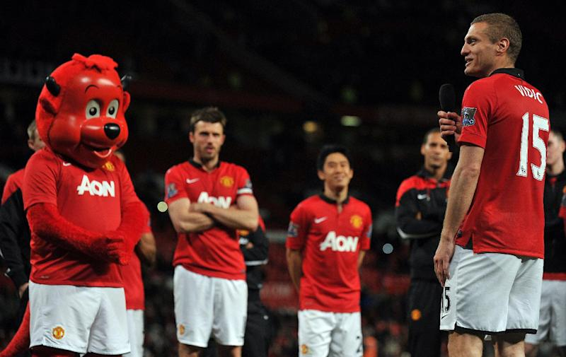 Manchester United players with the team mascot after a Premier League game against Hull City at Old Trafford on May 6, 2014