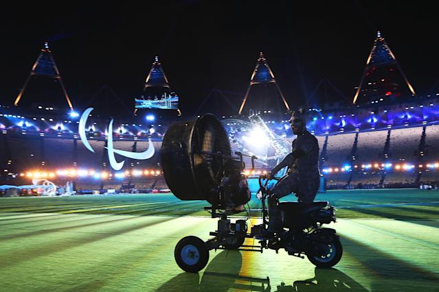 LONDON, ENGLAND - SEPTEMBER 09: A performer on a mechanised tricycle enters the arena during the closing ceremony on day 11 of the London 2012 Paralympic Games at Olympic Stadium on September 9, 2012 in London, England. (Photo by Peter Macdiarmid/Getty Images)