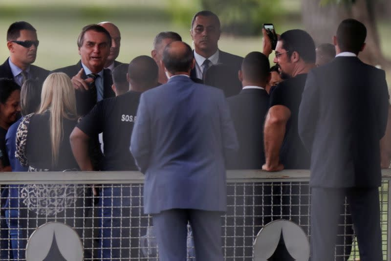Brazil's President Bolsonaro talks with supporters upon arrival at Alvorada Palace in Brasilia