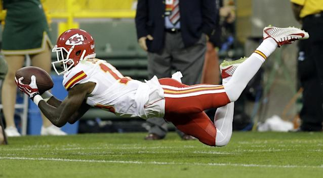 Kansas City Chiefs wide receiver A.J. Jenkins makes a diving catch during the first half of an NFL football preseason game against the Green Bay Packers Thursday, Aug. 28, 2014, in Green Bay, Wis. (AP Photo/Tom Lynn)