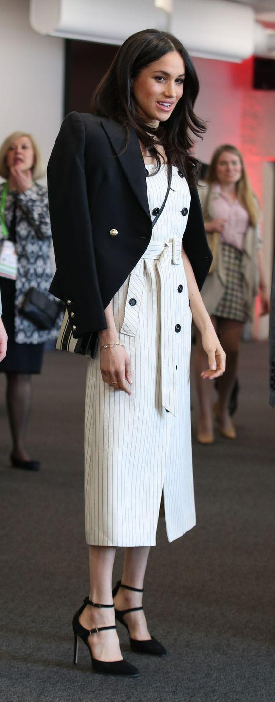 """<p>For a visit at the Commonwealth Youth Forum, the Suits star chose the stunning Audrey Pinstriped Stretch-Cotton Trench Dress from <a class=""""link rapid-noclick-resp"""" href=""""https://www.barneys.com/product/altuzarra-audrey-pinstriped-stretch-cotton-trench-dress-505512808.html?ranMID=38359&ranEAID=J84DHJLQkR4&ranSiteID=J84DHJLQkR4-WjXrmXoBuGGtZFdz0cWzqQ&siteID=J84DHJLQkR4-WjXrmXoBuGGtZFdz0cWzqQ"""" rel=""""nofollow noopener"""" target=""""_blank"""" data-ylk=""""slk:Altuzarra"""">Altuzarra</a> (which is available in the UK in navy from <a class=""""link rapid-noclick-resp"""" href=""""http://www.selfridges.com/GB/en/cat/altuzarra-audrey-pinstripe-twill-midi-dress_134-3004860-118315709/?previewAttribute=Navy"""" rel=""""nofollow noopener"""" target=""""_blank"""" data-ylk=""""slk:Selfridges"""">Selfridges</a>). She paired it with a black blazer from Australian label <a class=""""link rapid-noclick-resp"""" href=""""https://www.camillaandmarc.com/marguerite-blazer-black.html"""" rel=""""nofollow noopener"""" target=""""_blank"""" data-ylk=""""slk:Camilla and Marc"""">Camilla and Marc</a> and a monochrome Avalon Zip Top Crossbody handbag worth just £171 from <a class=""""link rapid-noclick-resp"""" href=""""https://www.oroton.com.au/avalon-zip-top-crossbody-black-cream-mix-osfa_1021672"""" rel=""""nofollow noopener"""" target=""""_blank"""" data-ylk=""""slk:Oroton"""">Oroton</a>, an Australian accessories brand.</p>"""