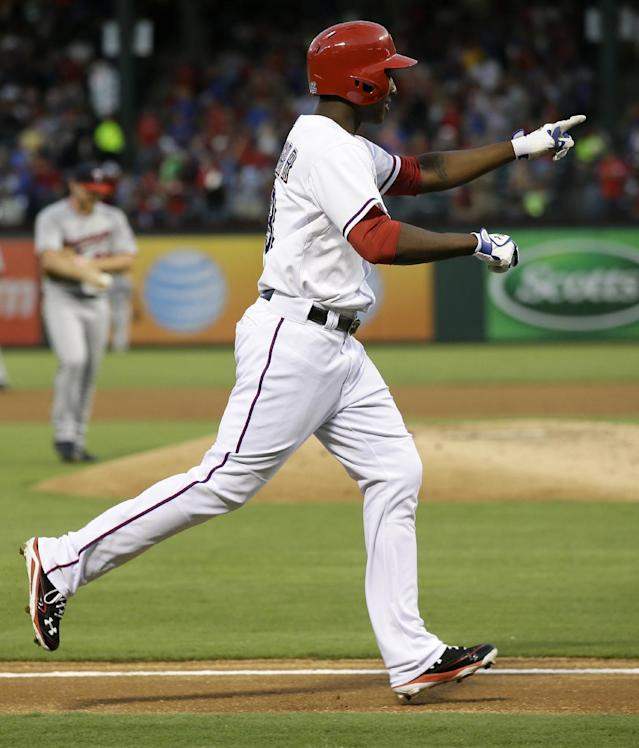 Texas Rangers' Jurickson Profar (13) points to the dugout as he approaches home on his solo home run off of Minnesota Twins starting pitcher Liam Hendriks, rear, in the third inning of a baseball game, Friday, Aug. 30, 2013, in Arlington, Texas. (AP Photo/Tony Gutierrez)