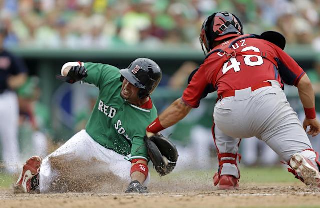 Boston Red Sox Shane Victorino, left, is tagged out at the plate by St. Louis Cardinals catcher Tony Cruz (48) on a fielders choice off the bat of David Ortiz in the fifth inning of an exhibition baseball game in Fort Myers, Fla., Monday, March 17, 2014. (AP Photo/Gerald Herbert)