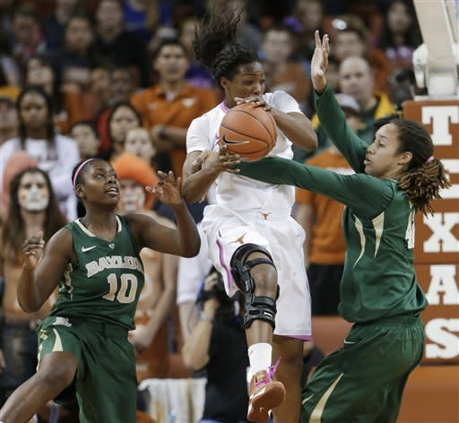 Baylor's Brittney Griner, right, and Destiny Williams, left, pressure Texas' Nneka Enemkpali during the first half of an NCAA college basketball game, Saturday, Feb. 9, 2013, in Austin, Texas. (AP Photo/Eric Gay)