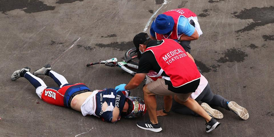Connor Fields lays on the ground and is treated by medical staff after a crash at the Tokyo Olympics.