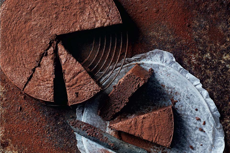 """Raw cacao powder retains a higher portion of nutrients than more common cocoa powder, which is usually heated during manufacturing. Swap the almond meal here for hazelnut meal, if you prefer. <a href=""""https://www.epicurious.com/recipes/food/views/flourless-cacao-fudge-cake?mbid=synd_yahoo_rss"""" rel=""""nofollow noopener"""" target=""""_blank"""" data-ylk=""""slk:See recipe."""" class=""""link rapid-noclick-resp"""">See recipe.</a>"""