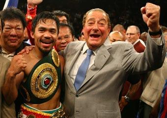 Manny Pacquiao celebrates with promoter Bob Arum after knocking down Ricky Hatton of England in the second round during their junior welterweight title fight in Las Vegas on May 2, 2009