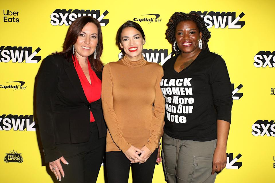 """Cori Bush, right, joins Amy Vilela, left, and Rep. Alexandria Ocasio-Cortez (D-N.Y.) at the premiere of the documentary """"Knock Down the House."""" The film raised Bush's profile. (Photo: Roger Kisby/Getty Images)"""