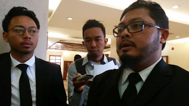 Lawyer Yusfarizal Yussoff (right) explains why his clients are suing JAWI over a wrongful khalwat raid and arrest as well as privacy breach. ― Picture by Ida Lim