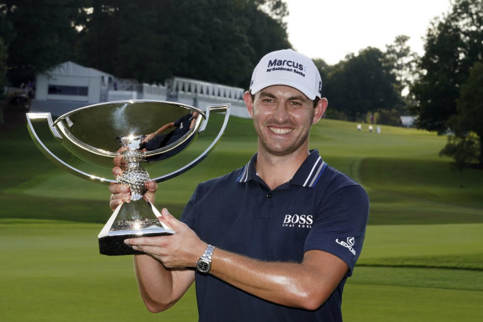 Patrick Cantlay poses with the trophy after winning the Tour Championship golf tournament and the FedEx Cup at East Lake Golf Club, Sunday, Sept. 5, 2021, in Atlanta. (AP Photo/Brynn Anderson)