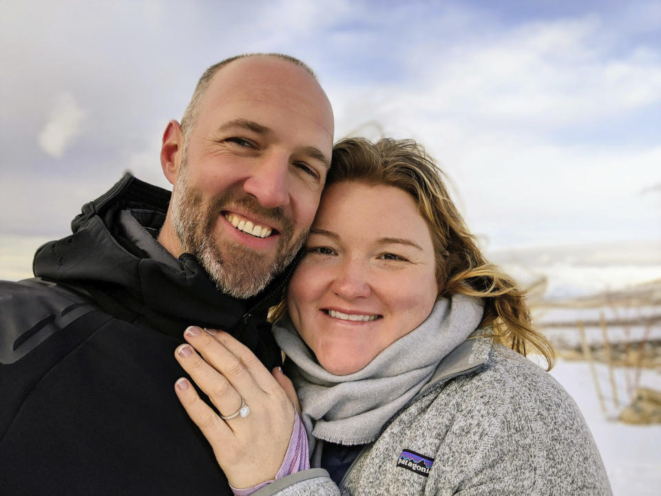 This photo shows Kate Whiting and Jake Avery on Feb. 6, 2020, soon after Avery proposed in Nevada's Ruby Mountains. The two had been planning a 300-person wedding but decided to marry June 6 in their backyard, with a big party after the coronavirus pandemic settles. They're feeding a trend toward micro weddings that has grown stronger since the health crisis sent millions into isolation. (Jake Avery via AP Photo)