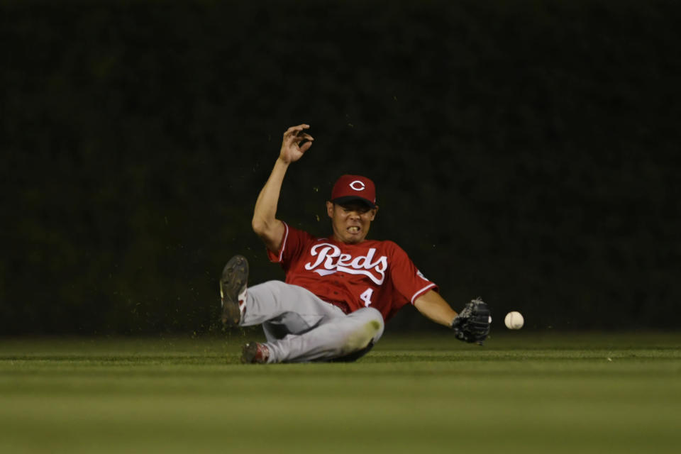Cincinnati Reds center fielder Shogo Akiyama misses a fly ball hit by Chicago Cubs' Jake Marisnick during the fifth inning of a baseball game Monday, July 26, 2021, in Chicago. (AP Photo/Paul Beaty)