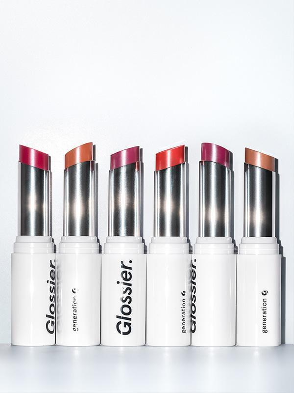 """Glossier's reformulated Generation G lipstick is a new favorite of mine. I love how comfortable and moisturizing it is. I use the color Zip, which is sheer and buildable but still packs such a punch that I don't need to wear anything else with it. It's the perfect holiday red lip for those who are a little bit color-shy like me. <em>—Khaliha Hawkins, producer</em> $18, Glossier. <a href=""""https://glossier.79ic8e.net/k32e0"""" rel=""""nofollow noopener"""" target=""""_blank"""" data-ylk=""""slk:Get it now!"""" class=""""link rapid-noclick-resp"""">Get it now!</a>"""