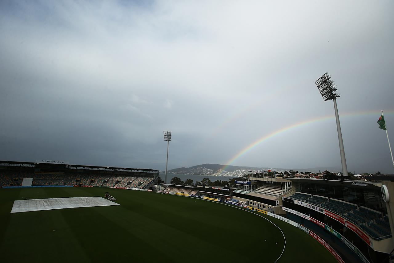 HOBART, AUSTRALIA - MARCH 24:  A rainbow is seen as rain delays play during day three of the Sheffield Shield final between the Tasmania Tigers and the Queensland Bulls at Blundstone Arena on March 24, 2013 in Hobart, Australia.  (Photo by Mark Metcalfe/Getty Images)