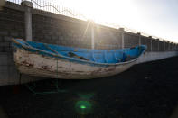 A wooden boat carrying the remains of migrant belongings is seen at the Arinaga port in Gran Canaria island, on Wednesday, Aug. 19, 2020. Some 4,000 migrants have reached the Canaries so far this year, the most in over a decade, raising alarm at the highest levels of the Spanish government. (AP Photo/Emilio Morenatti)