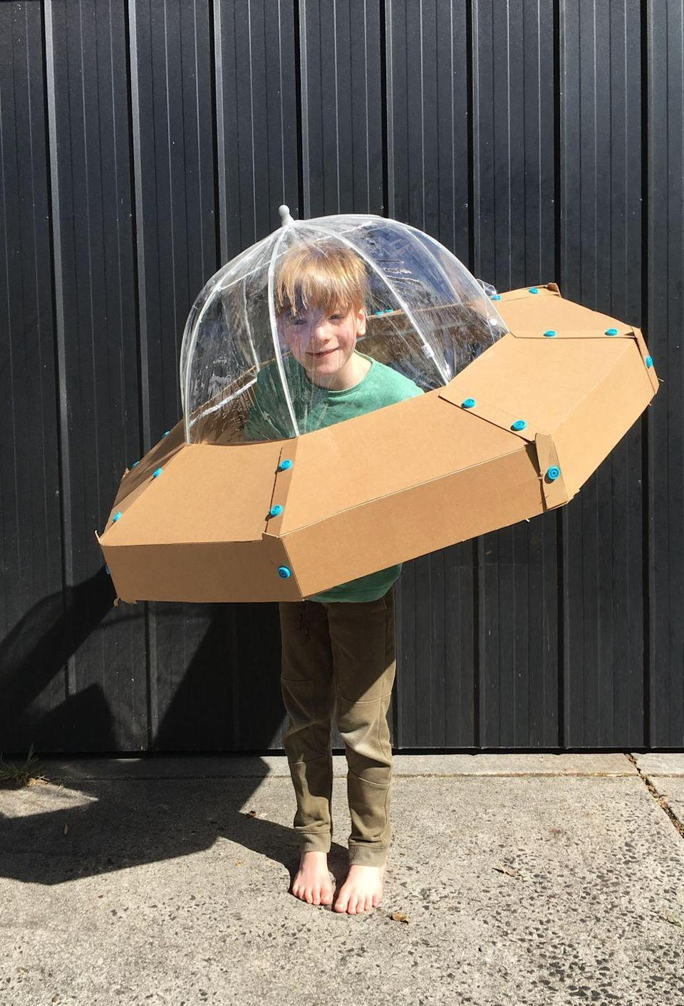 """<p>This is one of the coolest DIY Halloween costumes we've ever seen! Cardboard, a kid's clear umbrella, and a little time are all you'll need to invest in this amazing spaceship getup.</p><p><strong>Get the tutorial at <a href=""""https://www.zygotebrowndesigns.com/single-post/SPACESHIP"""" rel=""""nofollow noopener"""" target=""""_blank"""" data-ylk=""""slk:Zygote Brown Designs"""" class=""""link rapid-noclick-resp"""">Zygote Brown Designs</a>.</strong></p><p><a class=""""link rapid-noclick-resp"""" href=""""https://www.amazon.com/Totes-Bubble-Umbrella-Handle-Clear/dp/B017Y0KOOU/ref=sr_1_7?tag=syn-yahoo-20&ascsubtag=%5Bartid%7C10050.g.28496790%5Bsrc%7Cyahoo-us"""" rel=""""nofollow noopener"""" target=""""_blank"""" data-ylk=""""slk:SHOP KIDS UMBRELLAS"""">SHOP KIDS UMBRELLAS</a></p>"""