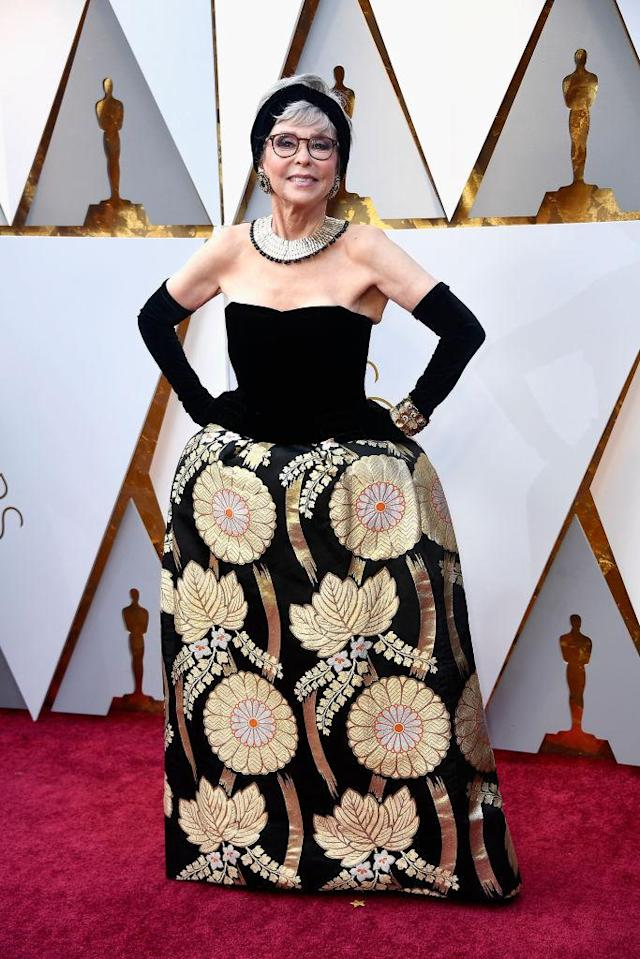 "<p>Rita Moreno, 86, chose a vintage gown with <a href=""https://www.yahoo.com/lifestyle/rita-moreno-rewears-oscars-gown-235700975.html"" data-ylk=""slk:special meaning"" class=""link rapid-noclick-resp"">special meaning</a> for her night at the 2018 Academy Awards. The gown is the very same one that she wore to the Oscars 56 years ago, when she won Best Actress in a Supporting Role in 1961's <i>West Side Story</i>. ""I would think it would tarnish!"" Moreno told Ryan Seacrest on the red carpet. But no, the dress was still golden on the radiant star. (Photo: Getty Images) </p>"
