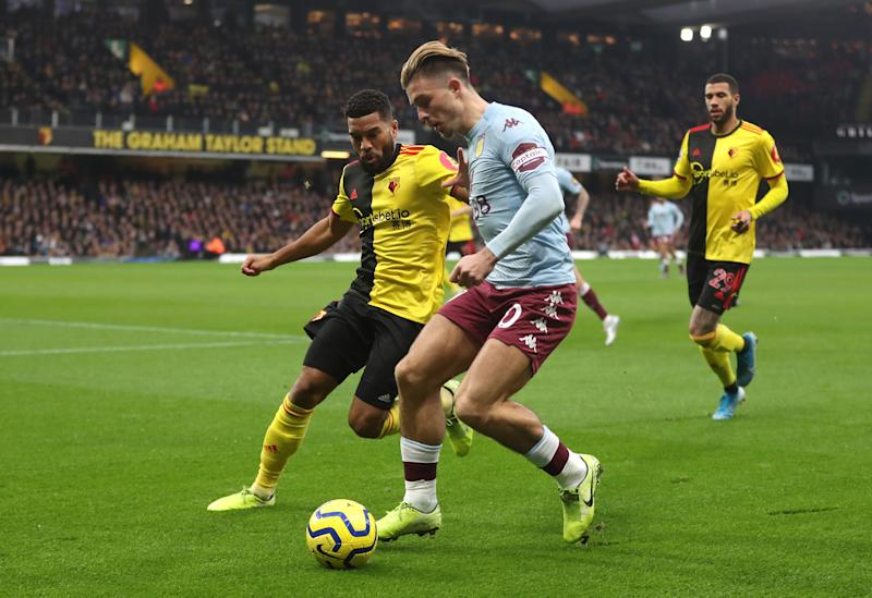 WATFORD, ENGLAND - DECEMBER 28: Jack Grealish of Aston Villa is put under pressure by Adrian Mariappa of Watford during the Premier League match between Watford FC and Aston Villa at Vicarage Road on December 28, 2019 in Watford, United Kingdom. (Photo by Catherine Ivill/Getty Images)
