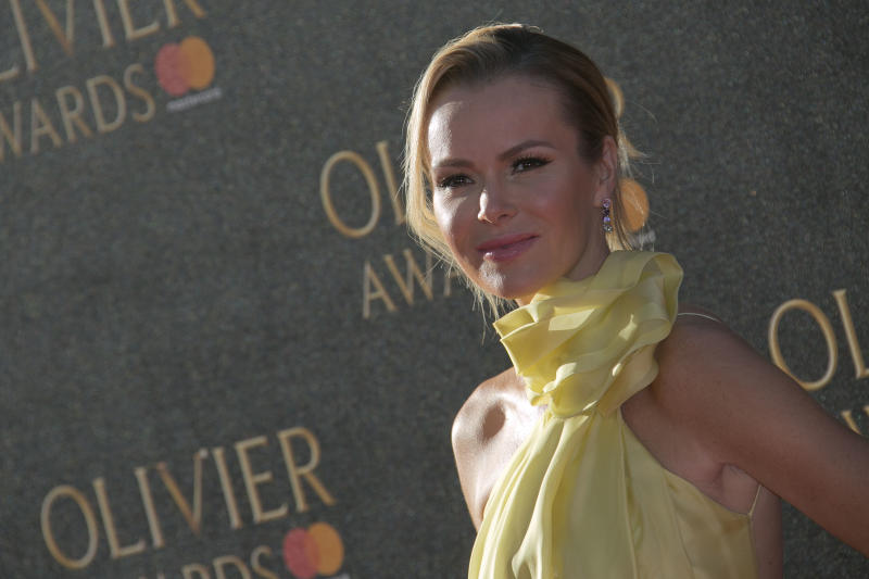 Amanda Holden poses for photographers as she arrives for the Olivier Awards at the Royal Albert Hall in central London, Sunday, April 9, 2017. (Photo by Joel Ryan/Invision/AP)