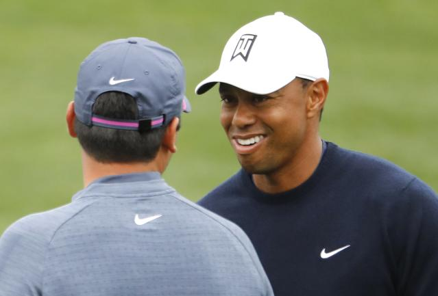 Tiger Woods of the U.S. talks with Jason Day of Australia (L) on the driving range during the final day of practice for the 2018 Masters golf tournament at Augusta National Golf Club in Augusta, Georgia, U.S. April 4, 2018. REUTERS/Jonathan Ernst