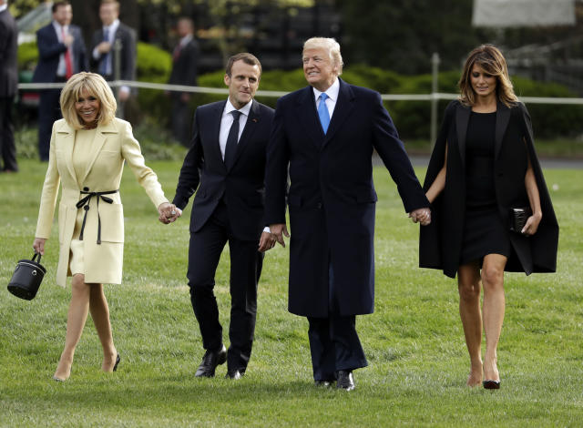 President Donald Trump and first lady Melania Trump greet French President Emmanuel Macron and his wife Brigitte Macron at the White House, Monday, April 3, 2018, in Washington. (AP Photo/Evan Vucci)