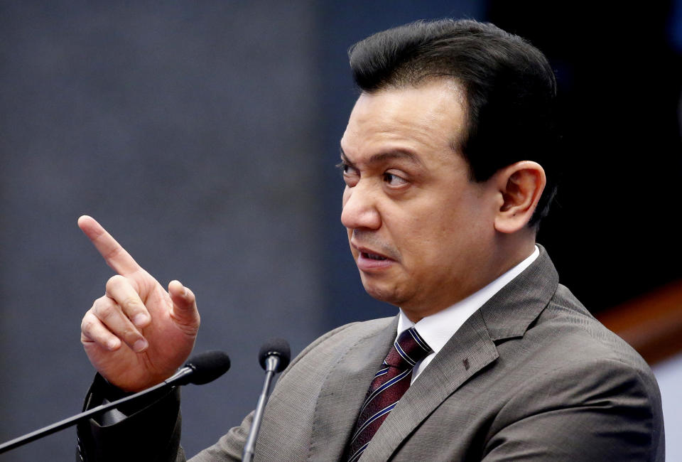 Former Senator Antonio Trillanes IV points to a malfunctioning power point presentation as he delivers a