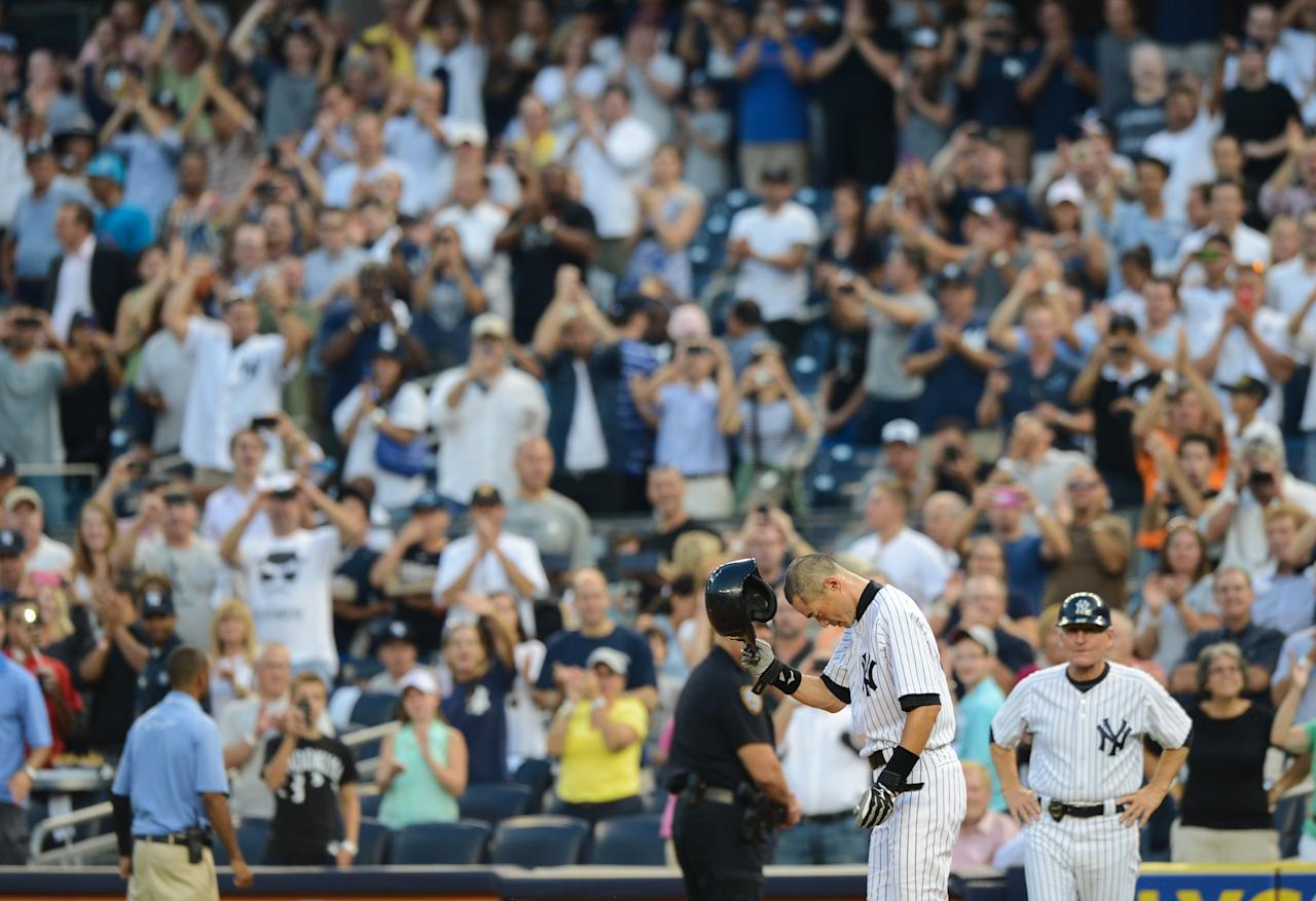 NEW YORK, NY - AUGUST 21: Ichiro Suzuki #31 of the New York Yankees acknowledges fans after his 4,000th career hit on a single in the 1st inning of the New York Yankees game against the Toronto Blue Jays at Yankee Stadium on August 21, 2013 in the Bronx borough of New York City. (Photo by Ron Antonelli/Getty Images)