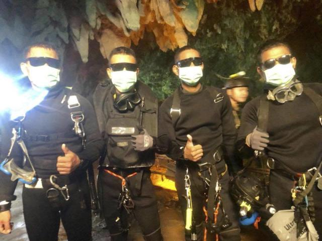 <p>In this undated photo released by Royal Thai Navy on Tuesday, July 10, 2018 show the last four Thai Navy SEALs come out safely after completing the rescued mission inside a cave where 12 boys and their soccer coach have been trapped since June 23, in Mae Sai, Chiang Rai province, northern Thailand. (Photo: Royal Thai Navy via AP) </p>