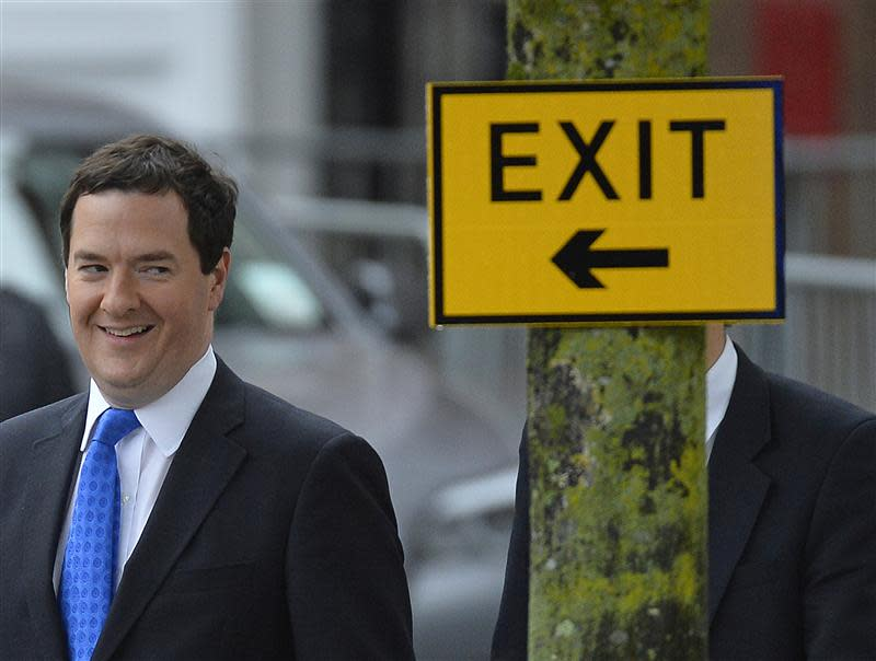 Britain's Chancellor of the Exchequer Osborne arrives to listen to PM Cameron's keynote speech to the Conservative Party annual conference in Manchester, northern England