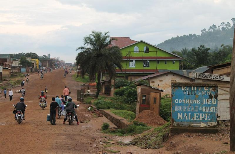 People walk in the street in the town of Beni, Democratic Republic of Congo, on October 20, 2014 (AFP Photo/Alain Wandimoyi)