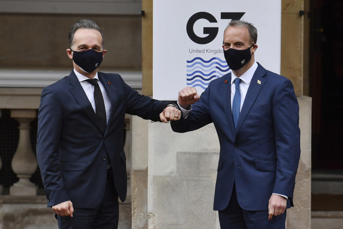 German Foreign Affairs Minister Heiko Maas, left, is greeted by Britain's Foreign Secretary Dominic Raab at the start of the G7 foreign ministers meeting in London Tuesday May 4, 2021. G7 foreign ministers meet in London Tuesday for their first face-to-face talks in more than two years. (Ben Stansall / Pool via AP)