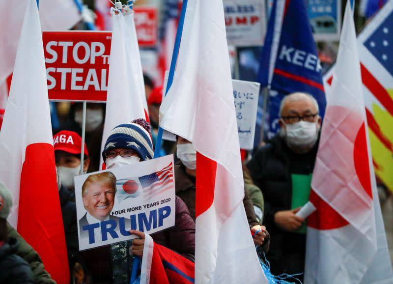 Supporters of U.S. President Donald Trump hold a rally, in Tokyo