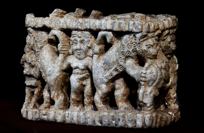 Bas-relief sculpture is displayed at the Iraqi National Museum in Baghdad, Iraq, Monday, April 1, 2013. Tens of thousands of artifacts chronicling some 7,000 years of civilization in Mesopotamia are believed to have been looted from Iraq in the chaos which followed the the US-led invasion in 2003. Despite international efforts to track items down, fewer than half of the artifacts have so far been retrieved. (AP Photo/Hadi Mizban)