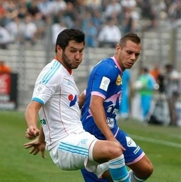 Marseille's French forward Andre-Pierre Gignac, left, challenges Evian's French forward Kevin Berigaud for the ball during their League One soccer match, at the Velodrome stadium, in Marseille, southern France, Sunday, Sept. 23, 2012. (AP Photo/Claude Paris)