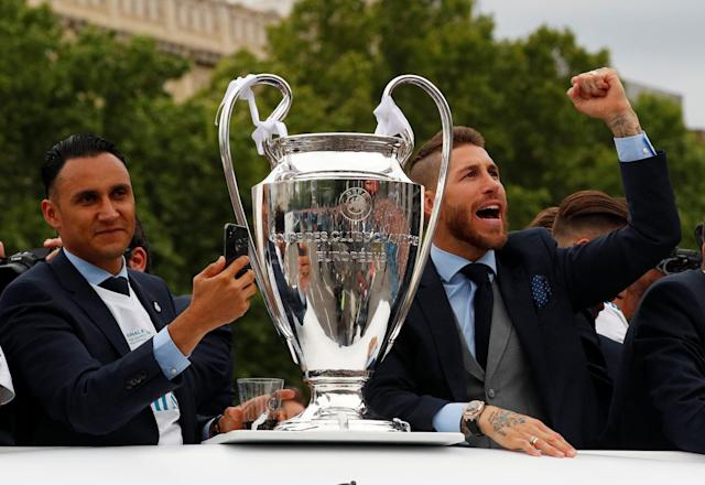 Soccer Football - Real Madrid celebrate winning the Champions League Final - Madrid, Spain - May 27, 2018 Real Madrid's Sergio Ramos and Keylor Navas celebrate on the bus during victory celebrations REUTERS/Paul Hanna