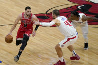 Chicago Bulls guard Zach LaVine, left, drives against Los Angeles Clippers center Ivica Zubac, center, and guard Terance Mann during the first half of an NBA basketball game in Chicago, Friday, Feb. 12, 2021. (AP Photo/Nam Y. Huh)